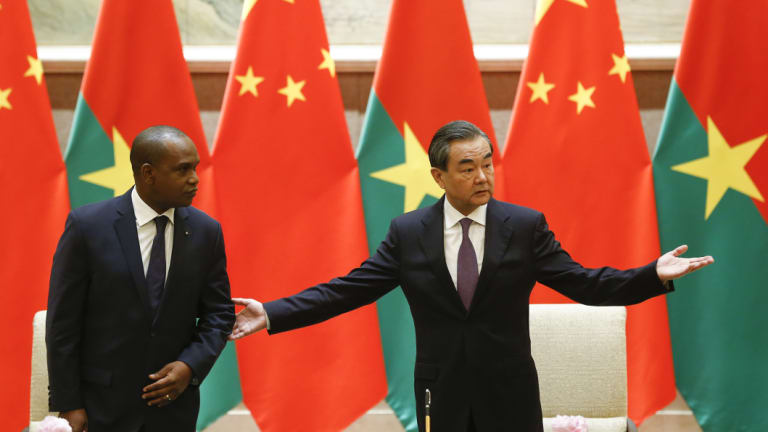 China's Foreign Minister Wang Yi (right) and Burkina Faso Foreign Minister Alpha Barry attend a signing ceremony establishing diplomatic relations in Beijing in May.