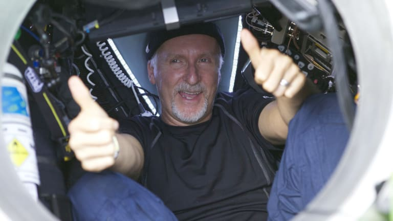 James Cameron gives two thumbs-up as he emerges from the Deepsea Challenger submersible in 2012 after his successful solo dive in the Mariana Trench.