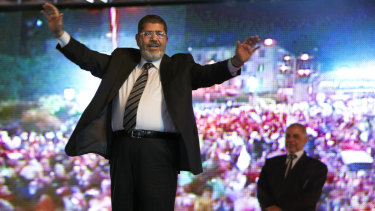 Then Muslim Brotherhood's presidential candidate Mohammed Morsi holds a rally in Cairo, Egypt, in 2012. He won the election a month later.