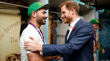 Spoils of victory: Springboks fullback Willie Le Roux meets Prince Harry in the winners' dressing room.