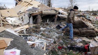 Hunter Lashley searches through the debris that was his home near Beauregard.