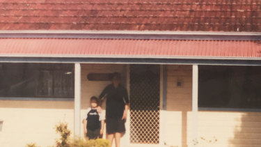 Historic photo of Ruben Mackellar (left) with older brother Thomas out the front of the family holiday house at Nambucca Heads.
