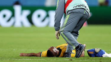 Kurtley Beale is treated by medical staff after copping a head knock during Australia's win over Georgia in Shizuoka.