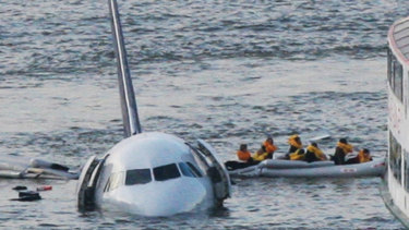 Passengers escape US Airways flight 1549 after Captain Chesley Sullenberger was able to safely land it in the Hudson River.