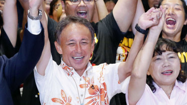 Japan's legislator Denny Tamaki, centre, celebrates his victory with supporters in the election for Okinawa governor in Naha city on  Sunday.