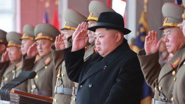Kim Jong-un watches a military parade in North Korea.