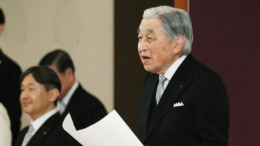 Japan's Emperor Akihito speaks during the ceremony of his abdication. His son and successor, Naruhito, is seen on the left.