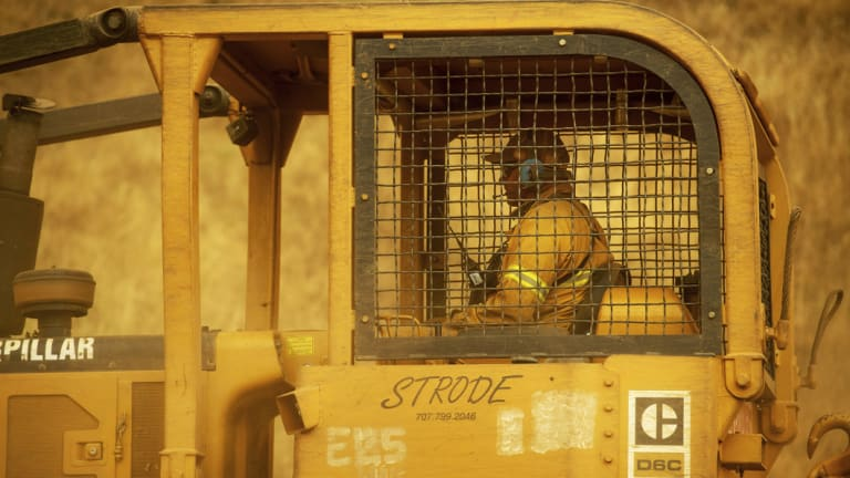 A bulldozer operator builds containment lines while battling the River fire in Lakeport. Not all firefighters carry a hose or a shovel. The adrenaline junkies who steer heavy bulldozers across steep ridges face many dangers, from the flames themselves but also from unsteady dirt and rocky terrain.