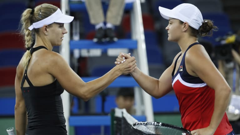 Ashleigh Barty shakes hands with Angelique Kerber after defeating the German.