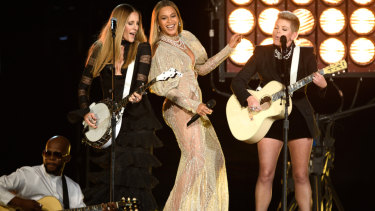 Beyonce wearing a gown by J'Aton at the 2016 Country Music Awards.