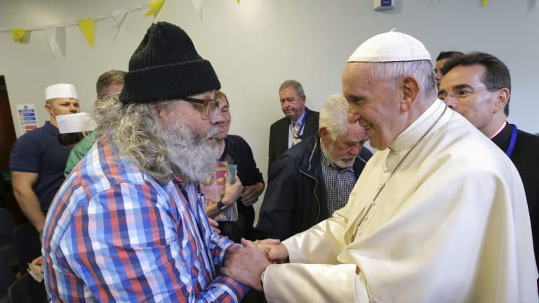 Pope Francis greets Aidan Walsh during a visit to the Capuchin Day Centre on Bowe Street in Dublin, as part of his visit to Ireland, on Saturday.