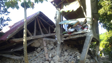 A damaged house in Itbayat town, Batanes islands, northern Philippines after a strong earthquake struck on Saturday.