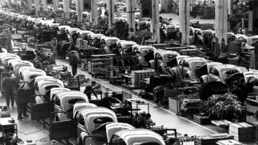Beetles are assembled in lines at the Volkwagen plan in Wolfsburg, West Germany, in 1964.