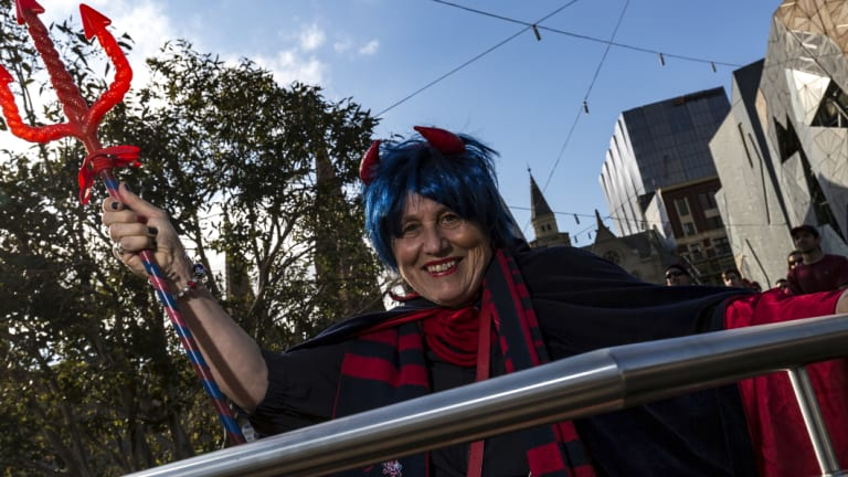 Jan Armstrong, who has followed the Dees for more than 50 years, joined hundreds of Melbourne supporters at Federation Square.