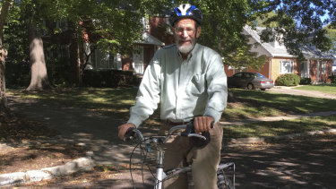 George Smith, professor emeritus at the University of Missouri who won the 2018 Nobel Prize for chemistry rides his bike on a biking/walking trail in Columbia.