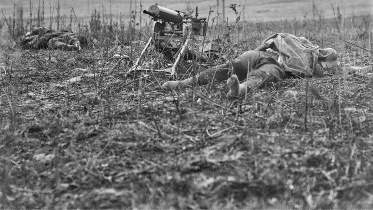 Men lie dead at Montbrehain, scene of the last battle involving Australian infantry on the Western Front.