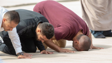 Mundine was one of many who joined the Friday prayers outside the Al Noor mosque.