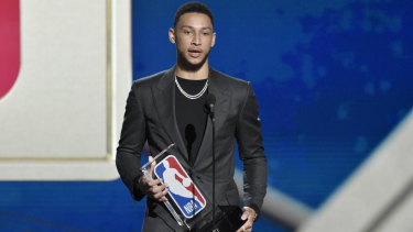 Ben Simmons, of the Philadelphia 76ers, accepts the Rookie of the Year Award in June.