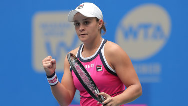 Ashleigh Barty has ensured she will retain the world's top ranking after reaching the Wuhan quarter-finals.