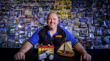 Building a career: Greg Horner, who trades in vintage and rare Lego through his business ToysRGo, shows some of the sought-after Lego pieces on sale at Brickvention.
