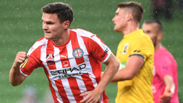 On target: Curtis Good celebrates after heading home to open the scoring for Melbourne City against Central Coast at AAMI Park.