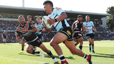 Sosaia Feki scores as Cronulla pile on the points in the second half.