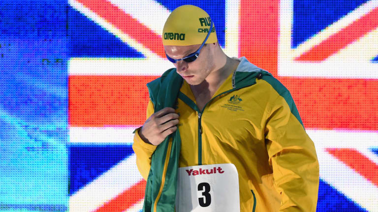 Focused: Kyle Chalmers walks onto the pool deck before winning the men's 100m freestyle final.