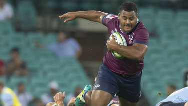 Reds' Taniela Tupou on the run against NSW Waratahs at the SCG in Sydney on Saturday.