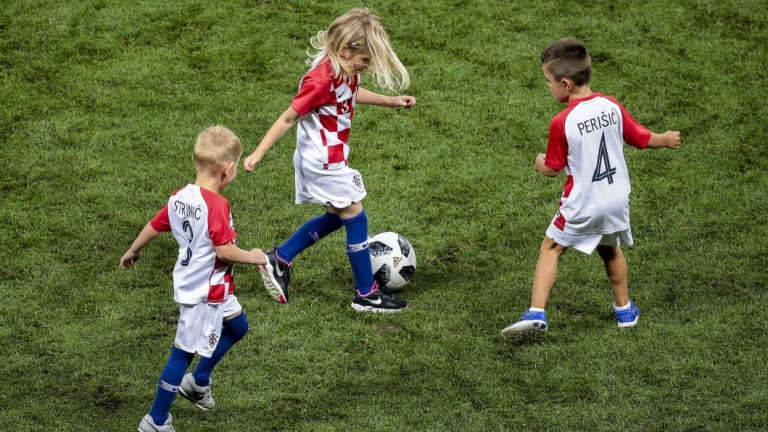 Children of the Croatian players celebrate victory at the end of the match against England