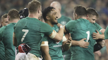 Common cause: Ireland's Josh van der Flier and Kiwi-born team mate Bundee Aki embrace after beating the All Blacks.