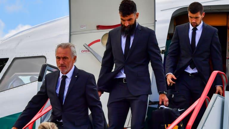 The Socceroos touch down: Coach Bert Van Marwijk and players Mile Jedinak and Mat Ryan disembark at Kazan airport.
