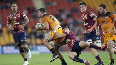 Matt McGahan (right) of the Reds tackles Pablo Matera of Jaguares during the round 16 clash at Suncorp Stadium on Saturday.