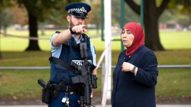 New Zealand police patrol the scene of last week's Christchurch massacre.