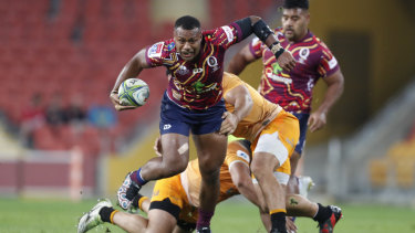 Hard to handle: Samu Kerevi makes a break for the Reds.