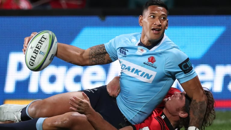 In form: Israel Folau scores a try for the NSW Waratahs against the Crusaders in Christchurch on Saturday.