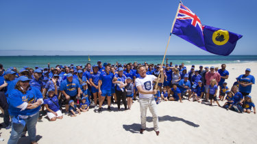 Billionaire Andrew Forrest declaring the Western Force saved in Cottesloe on November 20.