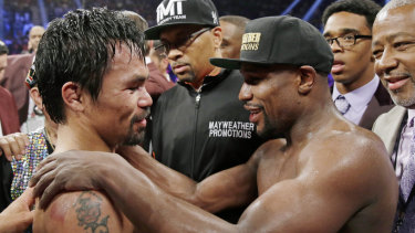Repeat: Manny Pacquiao (left) and Floyd Mayweather after their 2015 fight.
