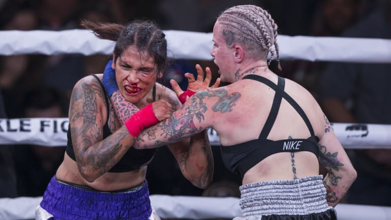 Gloves off: Alma Garcia, left, takes a hit from Bec Rawlings during their 125-pound bout.