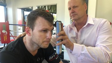 Changing the game: Noel Thornberry demonstrates the Infrascanner 2000 on boxer Jeff Horn.