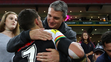 Tight: Ivan Cleary gives Nathan a hug after a Panthers game last season.