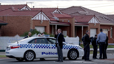 Homicide and forensic police at the scene of the stabbings in Kings Park on Saturday.