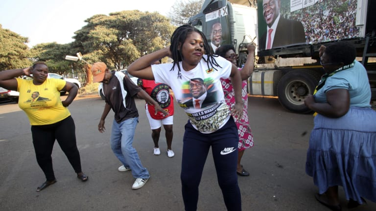 Supporters of Zimbabwean President Emmerson Mnangagwa celebrate in Harare.