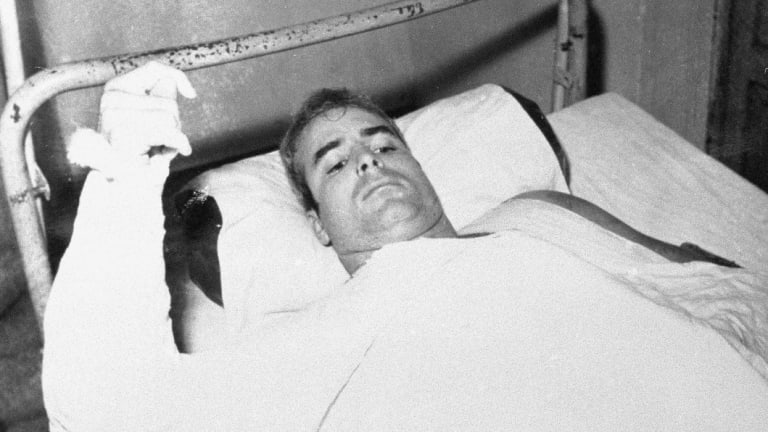In this undated file phot , US Navy Lieutenant Commander John S McCain lies injured in North Vietnam.