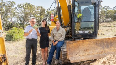 Royal Canberra Show chief executive Athol Chalmers launches the 'Dueling Excavators' competition with sponsors Yukari and Lee Carmody, of Drive This Canberra. The competition is part of a new-look main arena program at this year's Show.