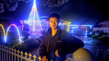 Minh Tuan Nguyen in front  of his home in Kings Park.