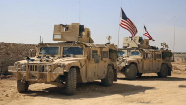US forces take up positions on the outskirts of the Syrian town of Manbij in 2017.