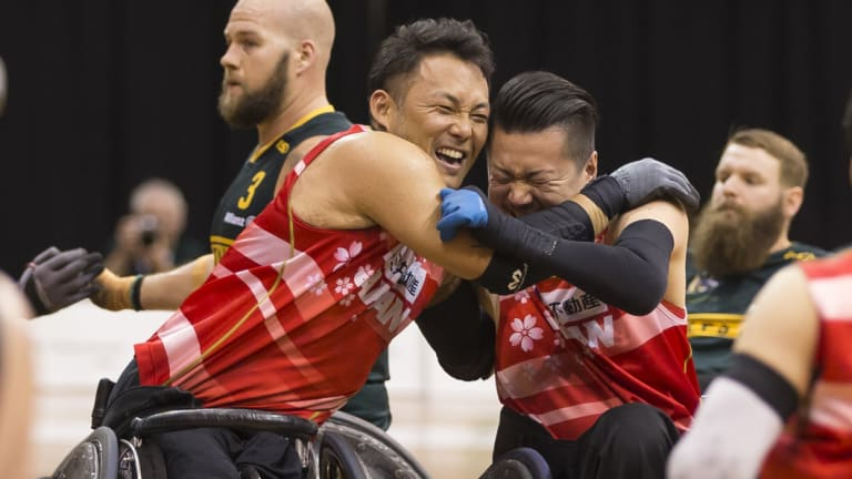 Jubilant: Japan celebrate at full-time after defeating Australia in the gold medal match at the Quaycentre in Sydney.