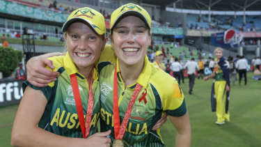 Ellyse Perry and Alyssa Healy celebrate after the team wins against England in the final of the ICC World Twenty20 in Bangladesh in 2014.