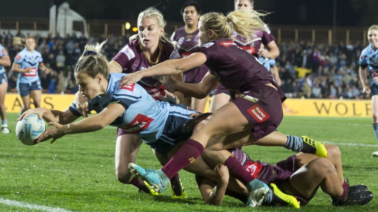 Breakthrough: Isabelle Kelly of the Blues scores the match winner during the State of Origin at North Sydney Oval.