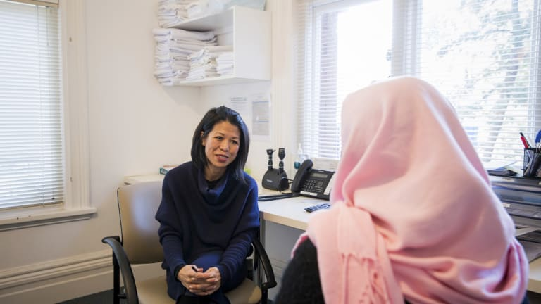 Tram Nguyen, the medical director and psychiatrist at Cabrini Asylum Seeker and Refugee Health Hub in Brunswick, speaks with a patient.